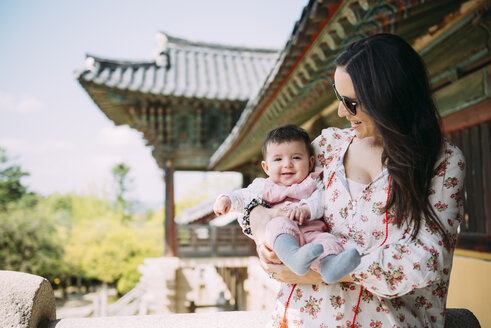 South Korea, Gyeongju, woman traveling with a baby girl in Bulguksa Temple - GEMF01617