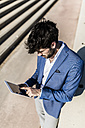 Young businessman using tablet outdoors - GIOF02607