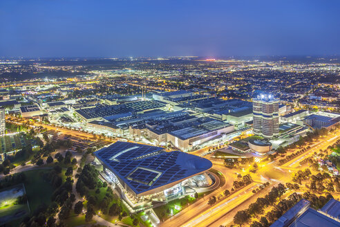 Germany, Bavaria, Munich, cityscape with BMW Headquarter near Olympic Park at night, drone photography - MMAF00095