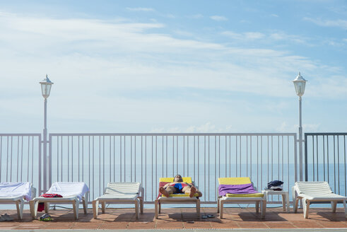 Tourist lying on sun bed of a hotel - SKCF00295