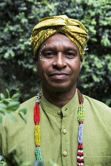 Portrait of content man wearing traditional Brazilian clothing - ABZF02023