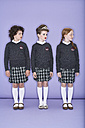 Three girls wearing school uniform standing side by side - FSF00881