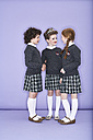 Three girls wearing school uniform talking - FSF00884