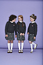 Three girls wearing school uniforms - FSF00896