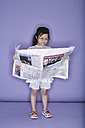Portrait of little girl with newspaper - FS00899