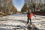 Woman ice skating on canal - MFF03509