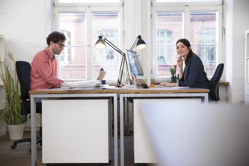 Man and woman working in office - FKF02251