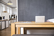 Laptop on desk in empty office - FKF02278