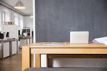 Laptop on desk in empty office - FKF02278