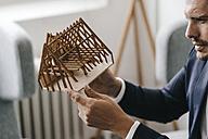 Architect examining architectural model - KNSF01282