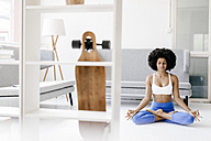 Fit young woman practicing yoga - KNSF01376