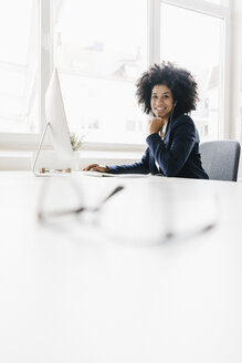 young businesswoman sitting in her office - KNSF01394