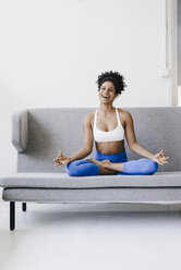 Fit young woman practicing yoga - KNSF01397