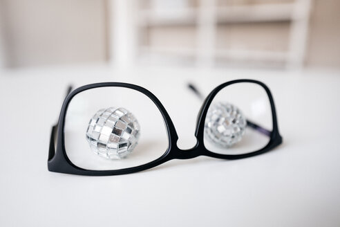Disco balls behind glasses frame - KNSF01439