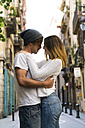 Young couple hugging in the city - KKAF00836