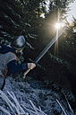 Back view of little boy wearing knight costume in nature - KNSF01449