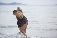 Two young women having fun in the sea - ZOCF00396