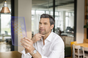 Businessman using futuristic portable device - PESF00608