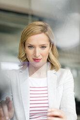 Businesswoman using futuristic portable device - PESF00614
