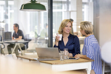 Two businesswomen working together in office - PESF00617
