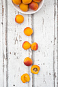 Sliced and whole apricots on wood - LVF06132