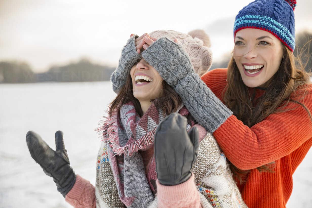 Playful friends on frozen lake - MFF03544 - Mareen Fischinger/Westend61