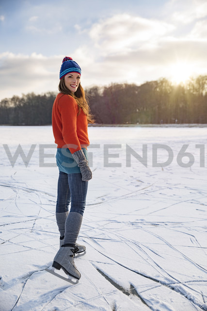 Portrait of woman ice skating on frozen lake - MFF03556