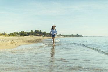 Woman walking at seaside - JPF00208