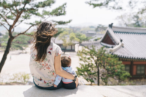 South Korea, Seoul, Mother and baby girl visiting Changdeokgung Palace and Huwon - GEMF01638