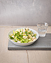Plate of Couscous salad with peas, cucumber and diced boiled chicken - KSWF01804