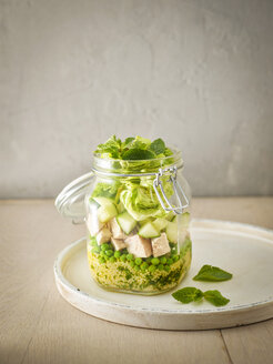 Preserving jar of Couscous salad with peas, cucumber and diced boiled chicken - KSWF01810