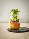 Preserving jar of wheat salad with vegetables, boiled egg and sliced steak - KSWF01813