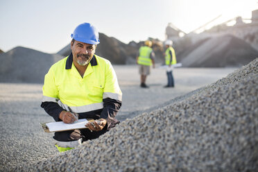 Quarry worker doing a quality check - ZEF13722