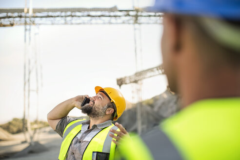Quarry worker on site talking on the phone - ZEF13725