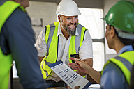 Workers discussing at site office - ZEF13746