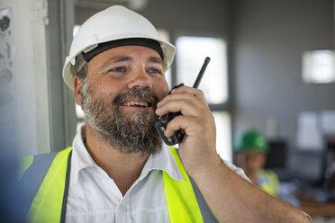 Quarry worker talking on radio device - ZEF13749