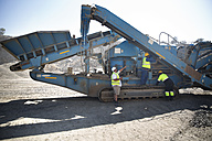 Workers in quarry maintaining dragline - ZEF13776