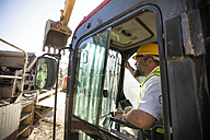 Worker driving a digger - ZEF13788