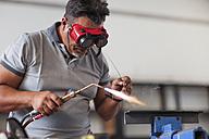 Mechanic welding in car workshop - ZEF13797