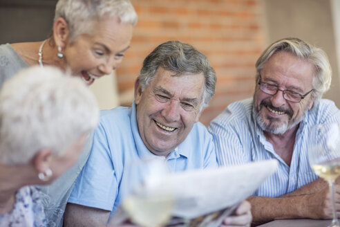 Portrait of smiling senior man having fun with his friends - ZEF13824