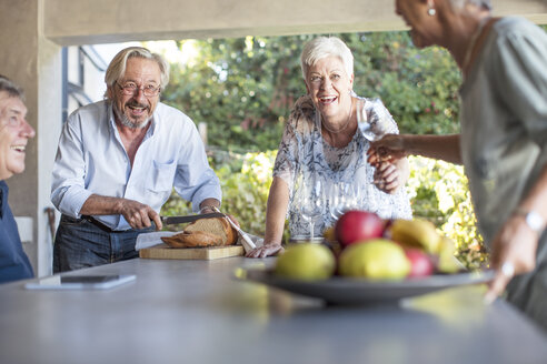 Two senior couples having fun together on terrace - ZEF13836