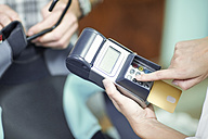 Paying with credit card in a shop - ZEF13849