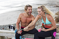 Couple having fun on the beach taking a selfie - ZEF13867