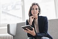 Portrait of confident businesswoman with tablet on couch - JOSF00955