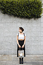 Young woman holding shopping bag - MRAF00197