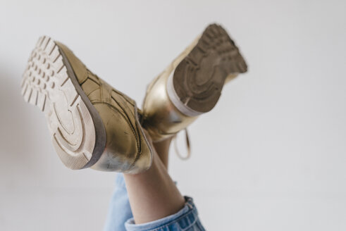 Close-up of woman wearing golden shoes - KNSF01505