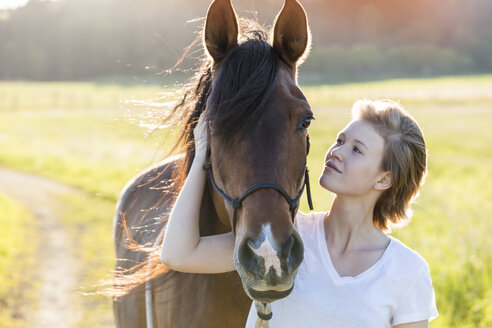 Young woman and horse in nature - TCF05423