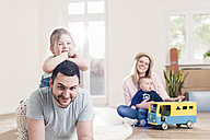 Portrait of happy family in new home - UUF10790