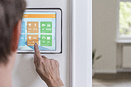 Woman using smart home screen - UUF10796