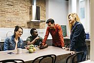 Colleagues having a break in office kitchen - JRFF01326